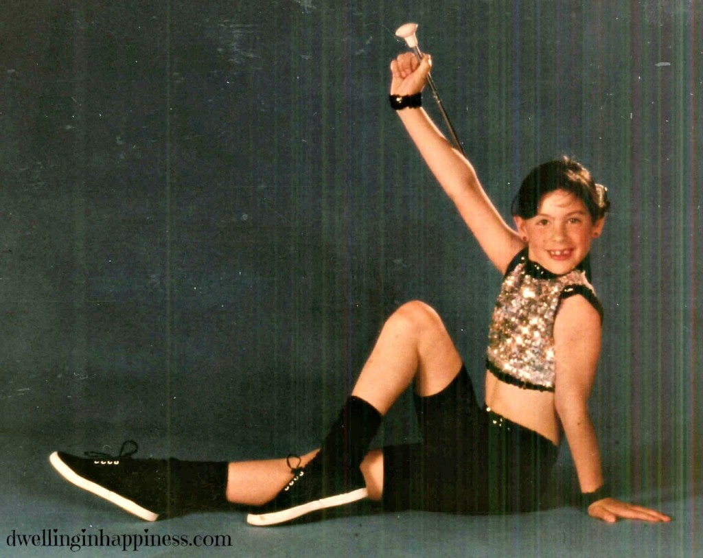 Totally rockin' that baton pose! And why were our costumes belly shirts at age 7?!