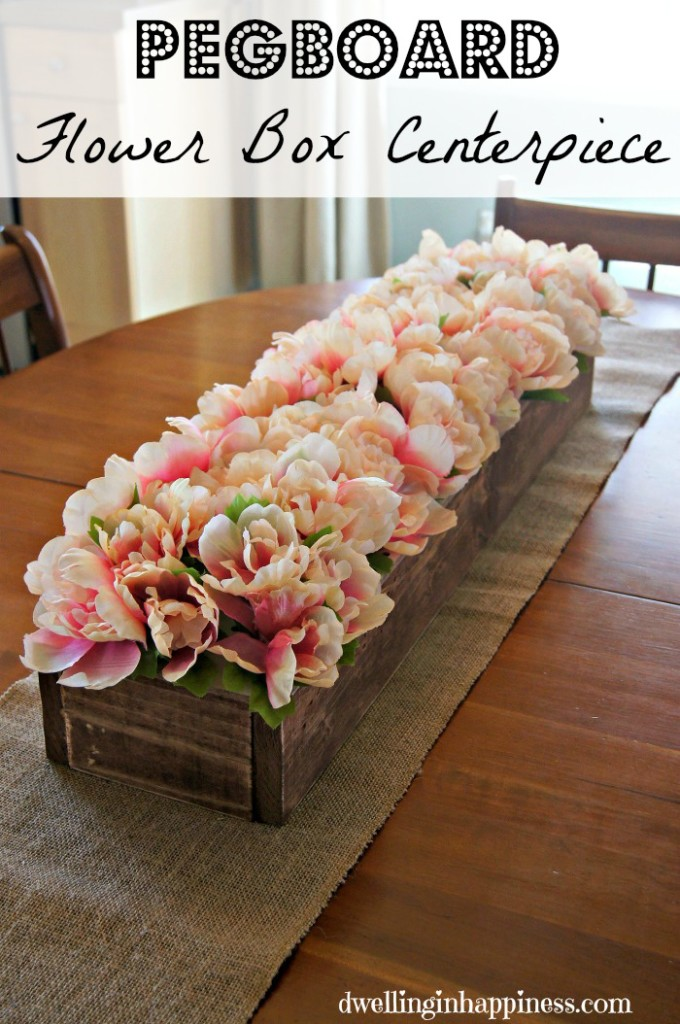GENIUS! Use pegboard and wood to make a centerpiece. Flower stems go right into each little hole to fill it up! Perfect for weddings, parties, and any season! From Dwelling in Happiness