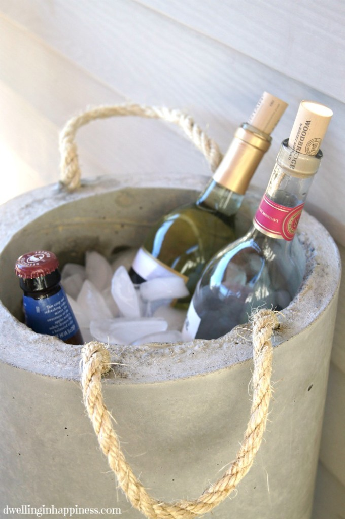 DIY Concrete Beverage Cooler! SUCH a cool way to display and keep your drinks cold for entertaining this summer! By Dwelling in Happiness